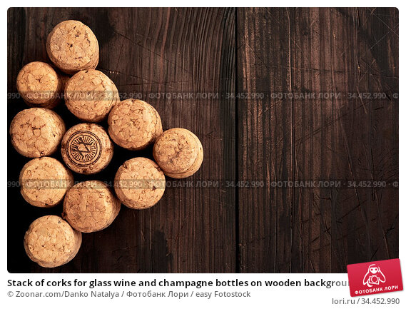 Stack of corks for glass wine and champagne bottles on wooden background... Стоковое фото, фотограф Zoonar.com/Danko Natalya / easy Fotostock / Фотобанк Лори