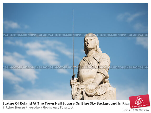 Купить «Statue Of Roland At The Town Hall Square On Blue Sky Background In Riga, Latvia. Famous Landmark. Old Architecture. Travel Destination.», фото № 28700274, снято 1 июля 2016 г. (c) easy Fotostock / Фотобанк Лори