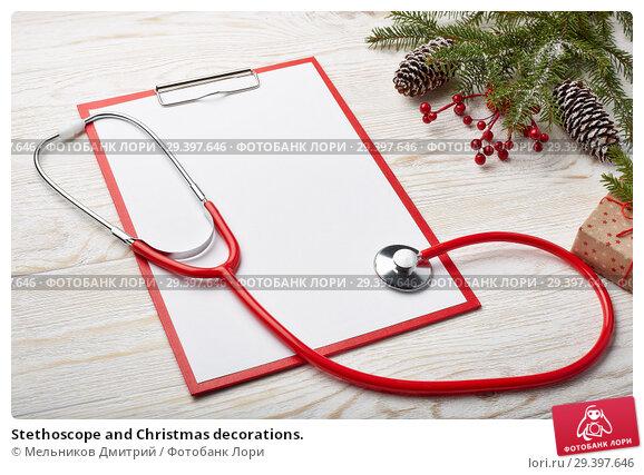 Купить «Stethoscope and Christmas decorations.», фото № 29397646, снято 4 ноября 2018 г. (c) Мельников Дмитрий / Фотобанк Лори