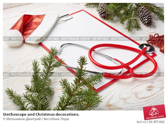 Купить «Stethoscope and Christmas decorations.», фото № 29397662, снято 4 ноября 2018 г. (c) Мельников Дмитрий / Фотобанк Лори
