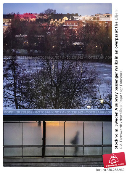 Купить «Stockholm, Sweden A subway passenger walks in an overpss at the Liljeholmen subway station with the frozen Trekanten lkae in the background.», фото № 30238962, снято 7 января 2019 г. (c) age Fotostock / Фотобанк Лори