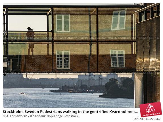 Stockholm, Sweden Pedestrians walking in the gentrified Kvarnholmen... Стоковое фото, фотограф A. Farnsworth / age Fotostock / Фотобанк Лори