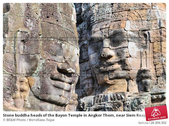 Купить «Stone buddha heads of the Bayon Temple in Angkor Thom, near Siem Reap, Cambodia», фото № 28309302, снято 12 декабря 2018 г. (c) BE&W Photo / Фотобанк Лори