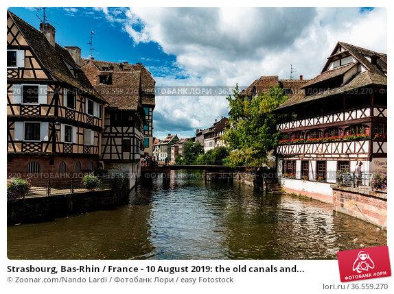 Strasbourg, Bas-Rhin / France - 10 August 2019: the old canals and... Стоковое фото, фотограф Zoonar.com/Nando Lardi / easy Fotostock / Фотобанк Лори