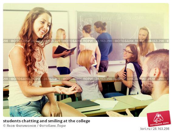 Купить «students chatting and smiling at the college», фото № 28163298, снято 15 ноября 2018 г. (c) Яков Филимонов / Фотобанк Лори