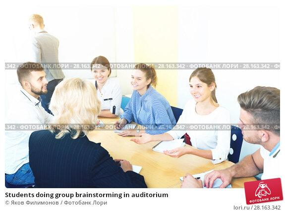 Купить «Students doing group brainstorming in auditorium», фото № 28163342, снято 5 октября 2017 г. (c) Яков Филимонов / Фотобанк Лори