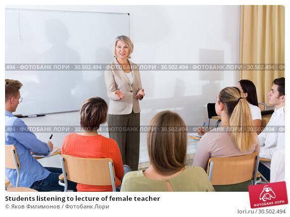 Купить «Students listening to lecture of female teacher», фото № 30502494, снято 14 апреля 2020 г. (c) Яков Филимонов / Фотобанк Лори