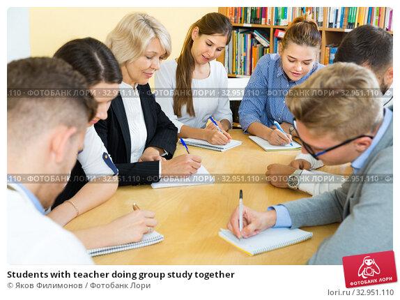 Students with teacher doing group study together. Стоковое фото, фотограф Яков Филимонов / Фотобанк Лори