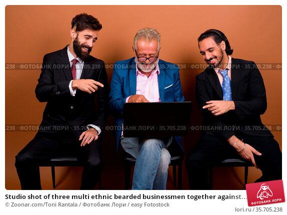 Studio shot of three multi ethnic bearded businessmen together against... Стоковое фото, фотограф Zoonar.com/Toni Rantala / easy Fotostock / Фотобанк Лори