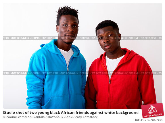 Studio shot of two young black African friends against white background. Стоковое фото, фотограф Zoonar.com/Toni Rantala / easy Fotostock / Фотобанк Лори