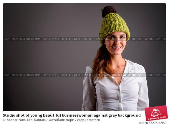 Studio shot of young beautiful businesswoman against gray background. Стоковое фото, фотограф Zoonar.com/Toni Rantala / easy Fotostock / Фотобанк Лори