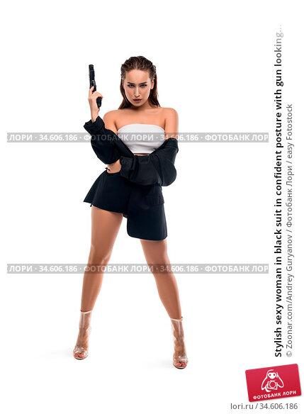 Stylish sexy woman in black suit in confident posture with gun looking... Стоковое фото, фотограф Zoonar.com/Andrey Guryanov / easy Fotostock / Фотобанк Лори