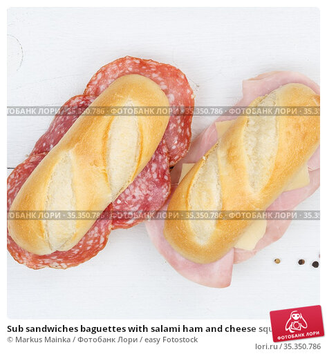 Sub sandwiches baguettes with salami ham and cheese square from above... Стоковое фото, фотограф Markus Mainka / easy Fotostock / Фотобанк Лори