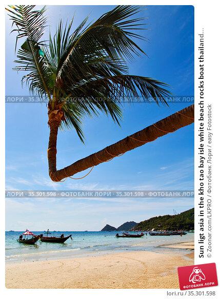 Sun ligt asia in the kho tao bay isle white beach rocks boat thailand... Стоковое фото, фотограф Zoonar.com/LKPRO / easy Fotostock / Фотобанк Лори