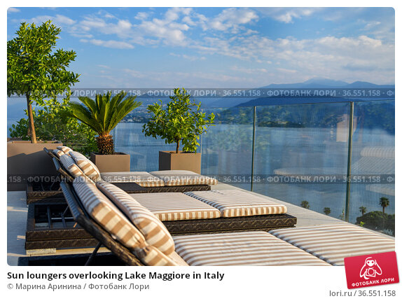 Sun loungers overlooking Lake Maggiore in Italy. Стоковое фото, фотограф Ирина Аринина / Фотобанк Лори