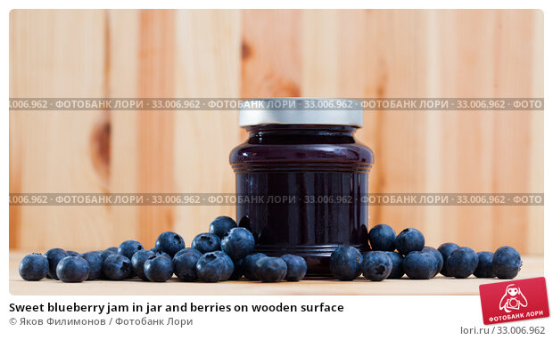 Sweet blueberry jam in jar and berries on wooden surface. Стоковое фото, фотограф Яков Филимонов / Фотобанк Лори