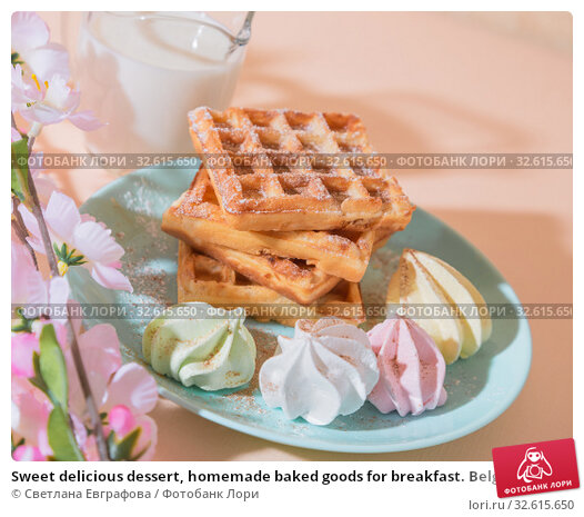 Купить «Sweet delicious dessert, homemade baked goods for breakfast. Belgian soft waffles on a blue plate with fresh milk and meringues on a peach-colored background in pastel tone», фото № 32615650, снято 30 ноября 2019 г. (c) Светлана Евграфова / Фотобанк Лори