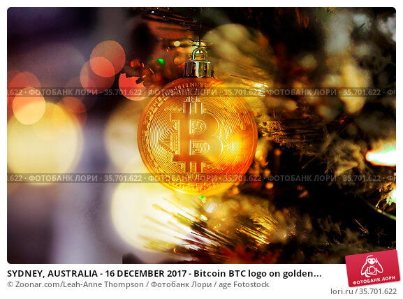 SYDNEY, AUSTRALIA - 16 DECEMBER 2017 - Bitcoin BTC logo on golden... Стоковое фото, фотограф Zoonar.com/Leah-Anne Thompson / age Fotostock / Фотобанк Лори