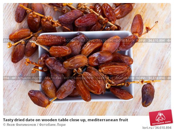 Tasty dried date on wooden table close up, mediterranean fruit. Стоковое фото, фотограф Яков Филимонов / Фотобанк Лори