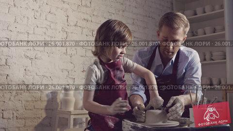 Купить «Teacher and child in studio», видеоролик № 26001870, снято 22 сентября 2019 г. (c) Raev Denis / Фотобанк Лори