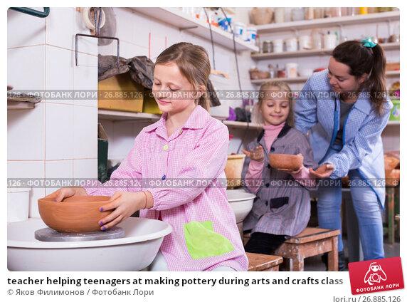 Купить «teacher helping teenagers at making pottery during arts and crafts class», фото № 26885126, снято 27 января 2020 г. (c) Яков Филимонов / Фотобанк Лори