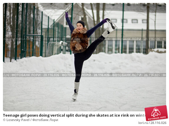Купить «Teenage girl poses doing vertical split during she skates at ice rink on winter day», фото № 28116026, снято 4 февраля 2017 г. (c) Losevsky Pavel / Фотобанк Лори