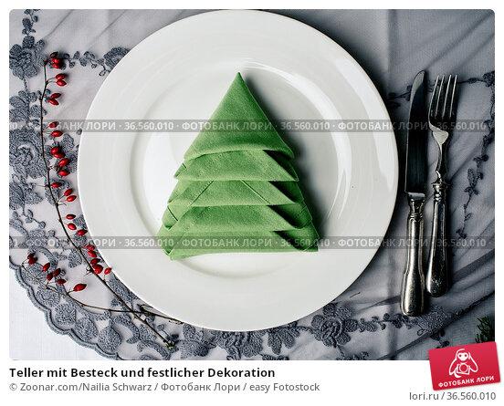 Teller mit Besteck und festlicher Dekoration. Стоковое фото, фотограф Zoonar.com/Nailia Schwarz / easy Fotostock / Фотобанк Лори