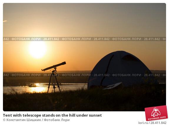 Купить «Tent with telescope stands on the hill under sunset», фото № 28411842, снято 14 мая 2018 г. (c) Константин Шишкин / Фотобанк Лори