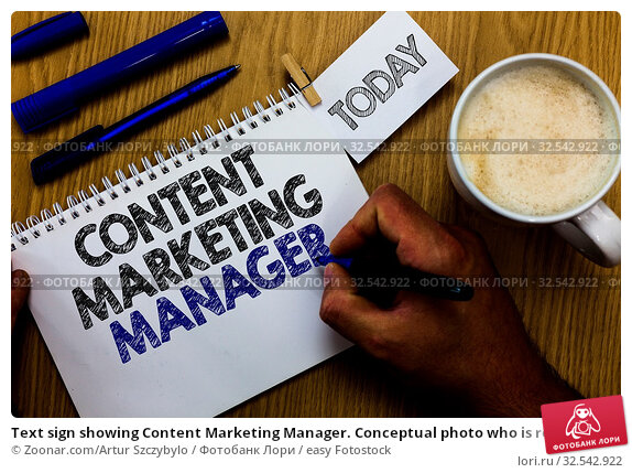 Купить «Text sign showing Content Marketing Manager. Conceptual photo who is responsible for writing posts and slogan Man holding marker notebook clothespin reminder wooden table cup coffee», фото № 32542922, снято 8 декабря 2019 г. (c) easy Fotostock / Фотобанк Лори
