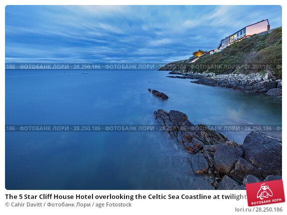 Купить «The 5 Star Cliff House Hotel overlooking the Celtic Sea Coastline at twilight, Dysert, Ardmore, Co. Waterford, Ireland.», фото № 28250186, снято 25 апреля 2018 г. (c) age Fotostock / Фотобанк Лори