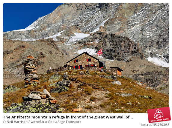 The Ar Pitetta mountain refuge in front of the great West wall of... Стоковое фото, фотограф Neil Harrison / age Fotostock / Фотобанк Лори