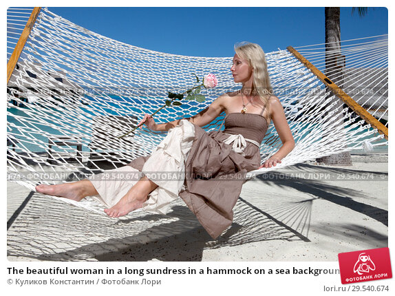 Купить «The beautiful woman in a long sundress in a hammock on a sea background», фото № 29540674, снято 18 июня 2011 г. (c) Куликов Константин / Фотобанк Лори