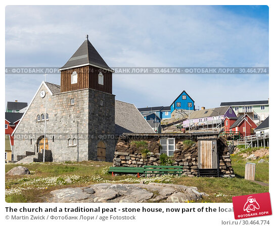 The church and a traditional peat - stone house, now part of the local museum. The town Uummannaq in the north of West Greenland, located on an island... Стоковое фото, фотограф Martin Zwick / age Fotostock / Фотобанк Лори