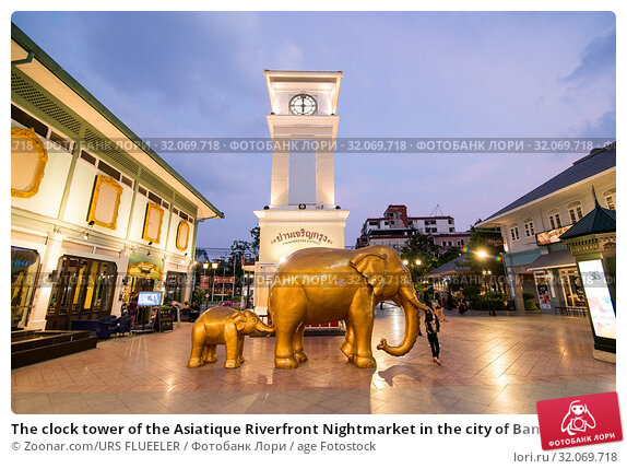 The clock tower of the Asiatique Riverfront Nightmarket in the city of Bangkok in Thailand. Thailand, Bangkok, November, 2017. Стоковое фото, фотограф Zoonar.com/URS FLUEELER / age Fotostock / Фотобанк Лори