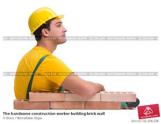 Купить «The handsome construction worker building brick wall», фото № 32334234, снято 5 ноября 2016 г. (c) Elnur / Фотобанк Лори