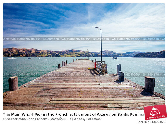 The Main Wharf Pier in the French settlement of Akaroa on Banks Peninsula... Стоковое фото, фотограф Zoonar.com/Chris Putnam / easy Fotostock / Фотобанк Лори