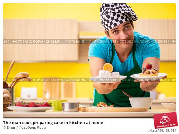 Купить «The man cook preparing cake in kitchen at home», фото № 29138914, снято 13 июня 2018 г. (c) Elnur / Фотобанк Лори