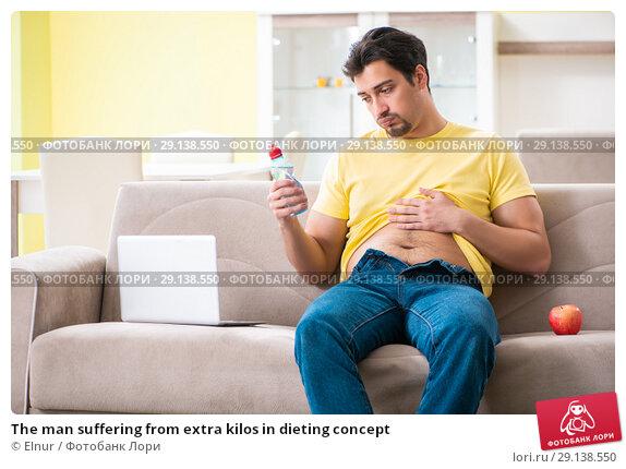 Купить «The man suffering from extra kilos in dieting concept», фото № 29138550, снято 11 мая 2018 г. (c) Elnur / Фотобанк Лори