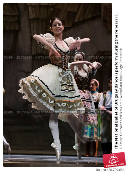Купить «The National Ballet of Uruguay dancers perform during the rehearsal of 'Coppelia' at El Canal Theatre in Madrid Featuring: Atmosphere Where: Madrid, Spain...», фото № 28700634, снято 27 декабря 2016 г. (c) age Fotostock / Фотобанк Лори