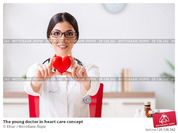 Купить «The young doctor in heart care concept», фото № 29138342, снято 5 июля 2018 г. (c) Elnur / Фотобанк Лори