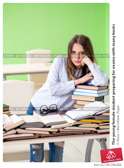 Купить «The young female student preparing for exams with many books», фото № 29138602, снято 8 июня 2018 г. (c) Elnur / Фотобанк Лори
