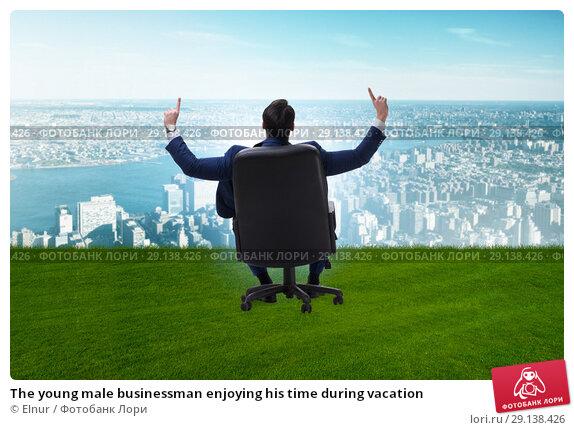 Купить «The young male businessman enjoying his time during vacation», фото № 29138426, снято 21 октября 2018 г. (c) Elnur / Фотобанк Лори