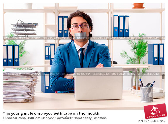 Купить «The young male employee with tape on the mouth», фото № 33835942, снято 30 мая 2020 г. (c) easy Fotostock / Фотобанк Лори