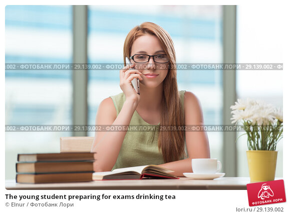Купить «The young student preparing for exams drinking tea», фото № 29139002, снято 21 июня 2016 г. (c) Elnur / Фотобанк Лори