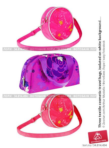 Three textile cosmetic travel bags, isolated on white background.... Стоковое фото, фотограф Zoonar.com/Arthur Mustafa / easy Fotostock / Фотобанк Лори