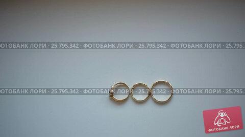 Купить «Three wedding rings», видеоролик № 25795342, снято 16 марта 2016 г. (c) Алексей Макаров / Фотобанк Лори