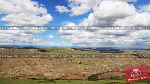 Купить «Timelapse view of the highland valley from the height of the hill», видеоролик № 26690726, снято 23 июля 2017 г. (c) Mikhail Starodubov / Фотобанк Лори
