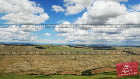 Купить «Timelapse view of the highland valley from the height of the hill», видеоролик № 26710934, снято 25 июля 2017 г. (c) Mikhail Starodubov / Фотобанк Лори