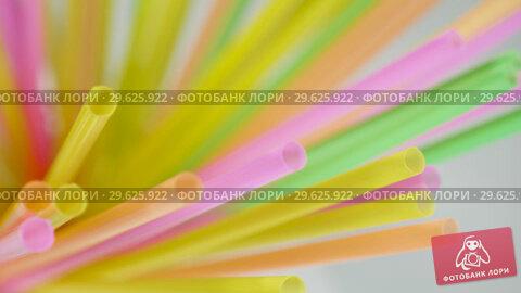 Купить «Top view of colorful straw on the rotation table», видеоролик № 29625922, снято 25 мая 2019 г. (c) Dzmitry Astapkovich / Фотобанк Лори