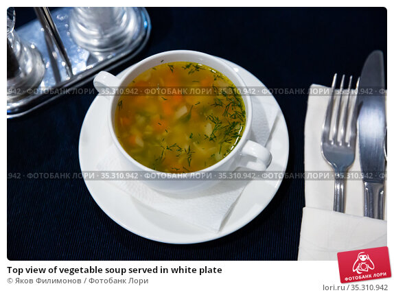 Top view of vegetable soup served in white plate. Стоковое фото, фотограф Яков Филимонов / Фотобанк Лори